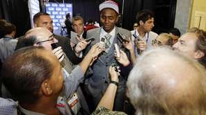 St. John's Maurice Harkless, center, talks to reporters