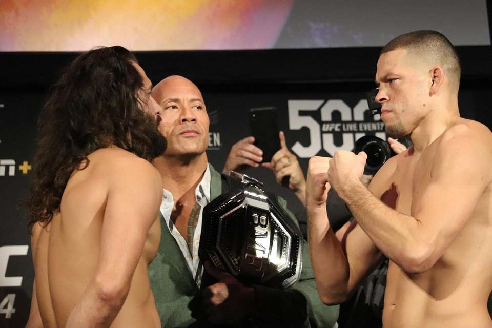 Jorge Mazvidal and Nate Diaz appear with Dwayne