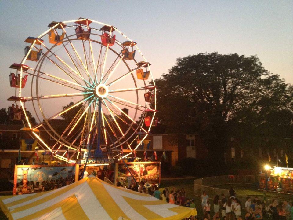 The Expo Wheel lights up as the sun