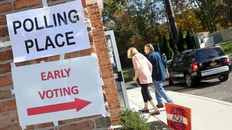 Voters arrive for the first day of early
