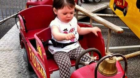Maggie Berger, 1, of Oceanside, on her first