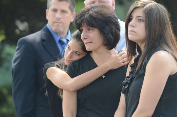 Friends and family attend a during funeral service