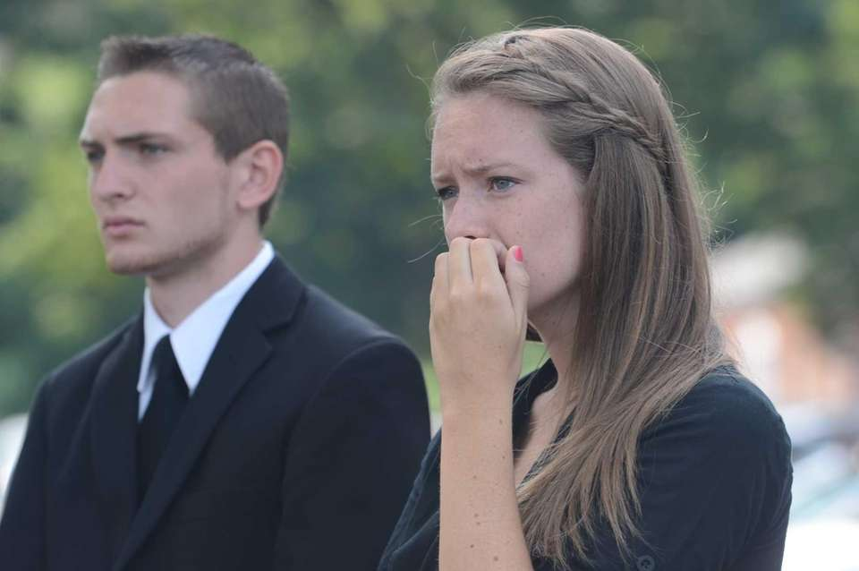 Friends and family attend a funeral service for