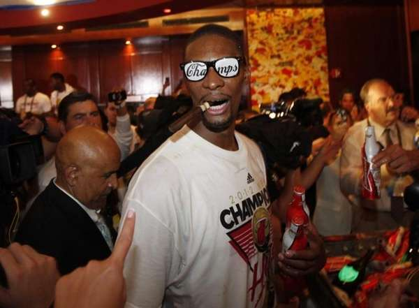 The Miami Heat's Chris Bosh celebrates in the