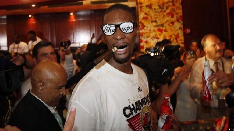 The Miami Heat's Chris Bosh celebrates in the