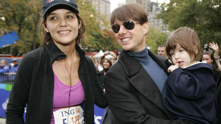 Katie Holmes joins Tom Cruise as he holds