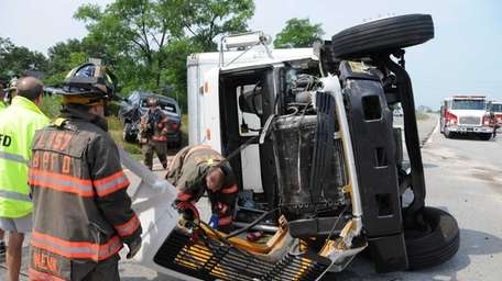 Two trucks and one car were involved in