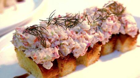 A Luce & Hawkins mini lobster roll is