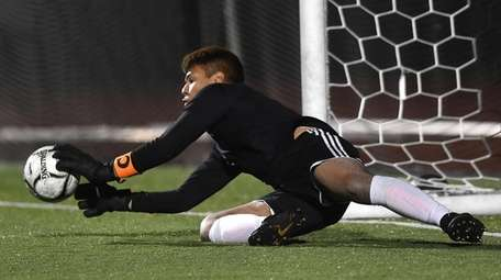 Uniondale keeper Endi Fernandez makes a save during