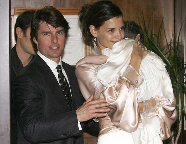 Tom Cruise and Katie Holmes, with their daughter