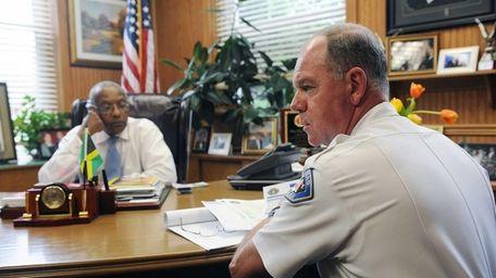 Hempstead Mayor Wayne Hall, left, and Hempstead Police
