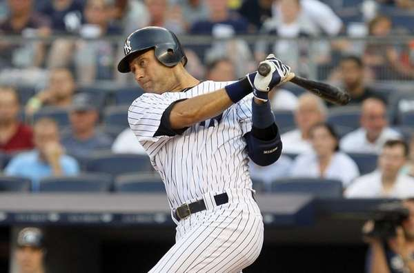 Derek Jeter follows through on a first inning