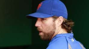Mets starting pitcher R.A. Dickey enters the dugout