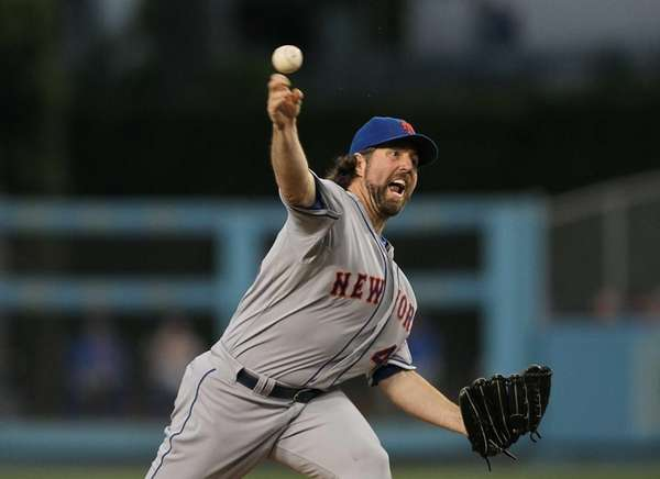 Starter R.A. Dickey pitches during the third inning.