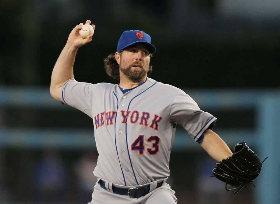 Starter R.A. Dickey pitches in the third inning.