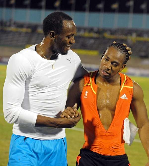 World champion Yohan Blake, right, is congratulated by