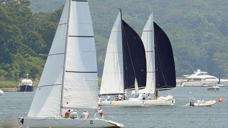 Boaters in sailboats keep cool during a regatta