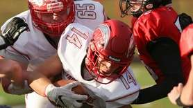 Connetquot's Cole Bunicci moves the ball in the