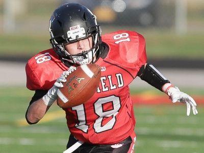 Newfield's Joseph Peyton Hackal (18) gets taken down
