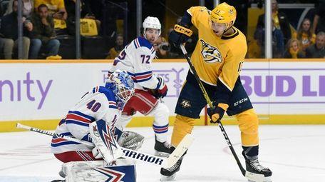 Rangers goaltender Alexandar Georgiev stops a shot as