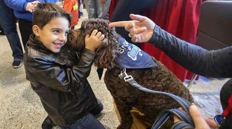 Chase Cotgreave, 7, of Smithtown, meets Brody, a