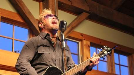 Paul Mahos of New Life Crisis performs Friday