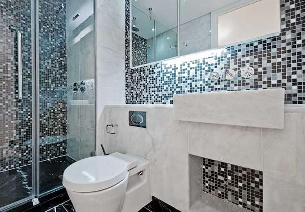 Superb Mixing Black, White And Gray Tile With Metal Accents Makes A Bathroom  Both Trendy