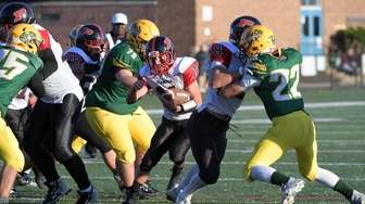 Joe Leone of Plainedge carries the football in