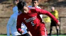 Southold midfielder Daniel Palencia moves the ball through