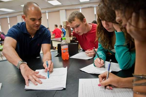 Regents Chemistry teacher Martin Palermo teaches students (L-R)