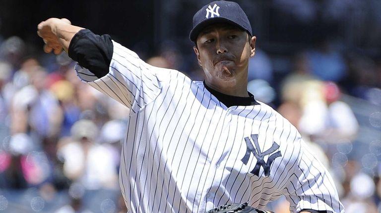 Hiroki Kuroda throws to first base during the