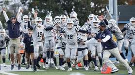 The Oceanside bench celebrates their go-ahead touchdown with