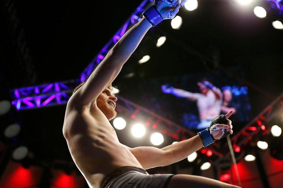 Edmen Shahbazyan (blue gloves) celebrates his victory over
