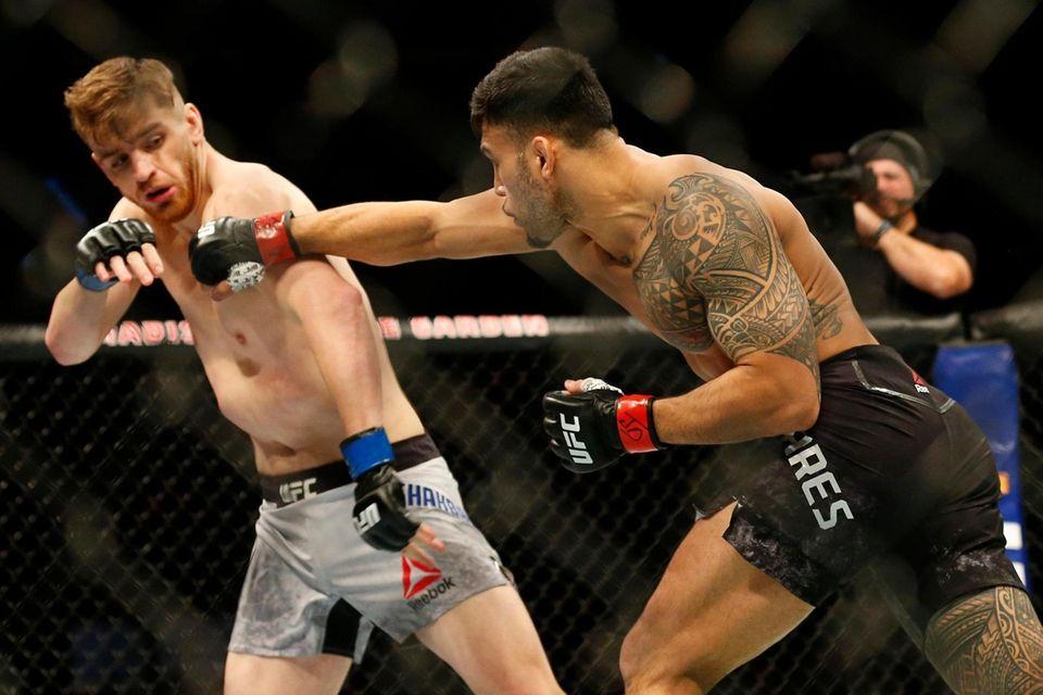 Brad Tavares (red gloves) fights against Edmen Shahbazyan