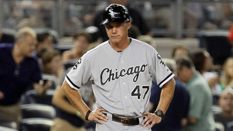 Third base coach Joe McEwing of the Chicago