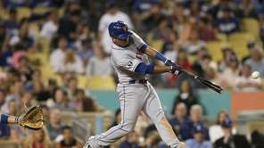 Ruben Tejada singles to center field in the