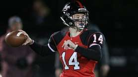Long Island Lutheran quarterback George Rosenberg drops back