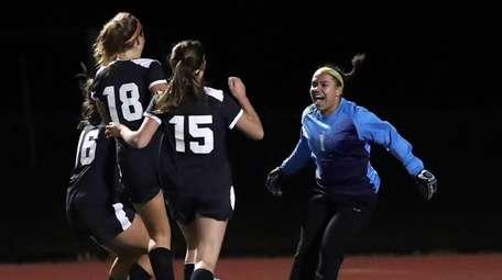 Babylon goalie Emma Ward reacts with teamates after