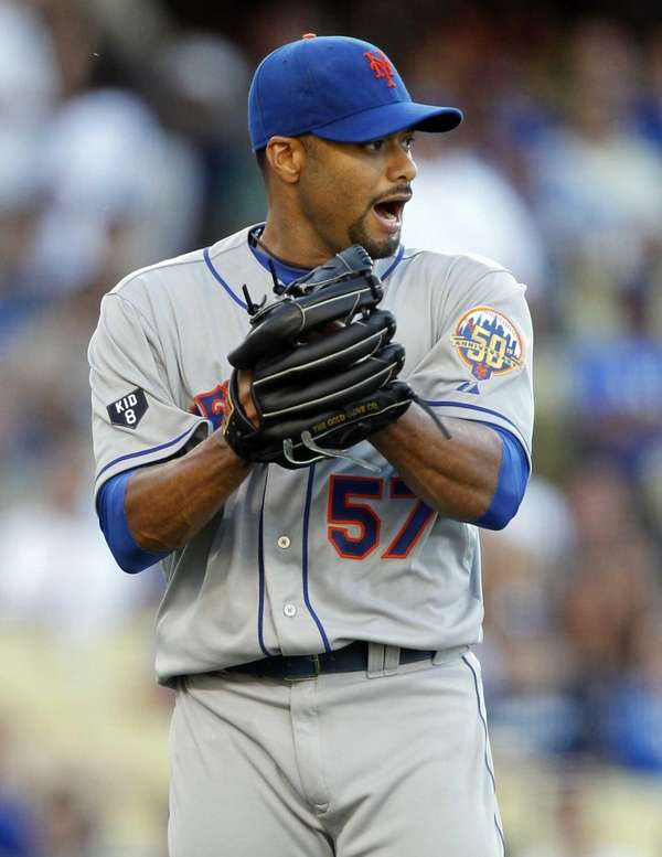 Johan Santana lets out a yell after Dee