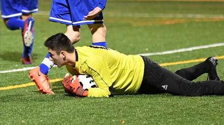 Kellenberg's Theodore Healy with the save during the