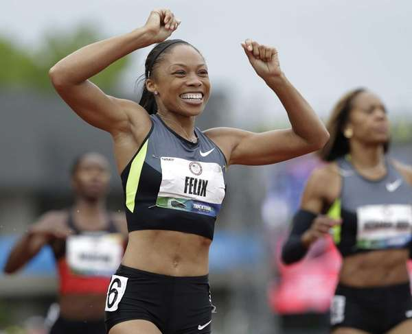 Allyson Felix celebrates her first place finish in