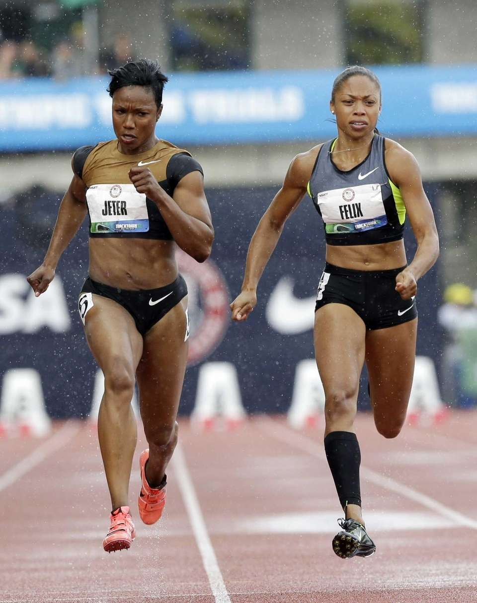 Carmelita Jeter and Allyson Felix compete in the