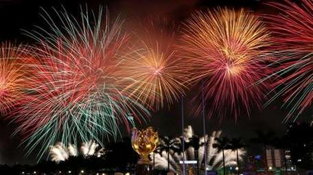 Fireworks explode over Victoria Harbor in Hong Kong