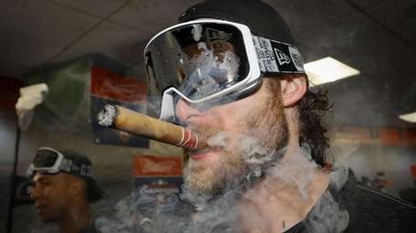 Astros starting pitcher Gerrit Cole celebrates in the