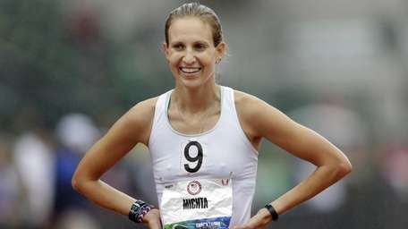 Maria Michta smiles after winning the women's 20