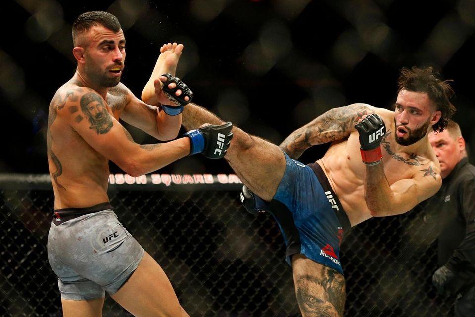 Shane Burgos (red gloves) fights against Makwan Amirkhani