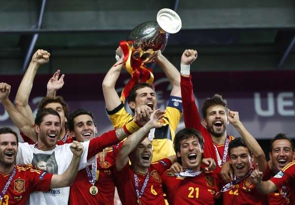 Spain goalkeeper Iker Casillas holds up the trophy