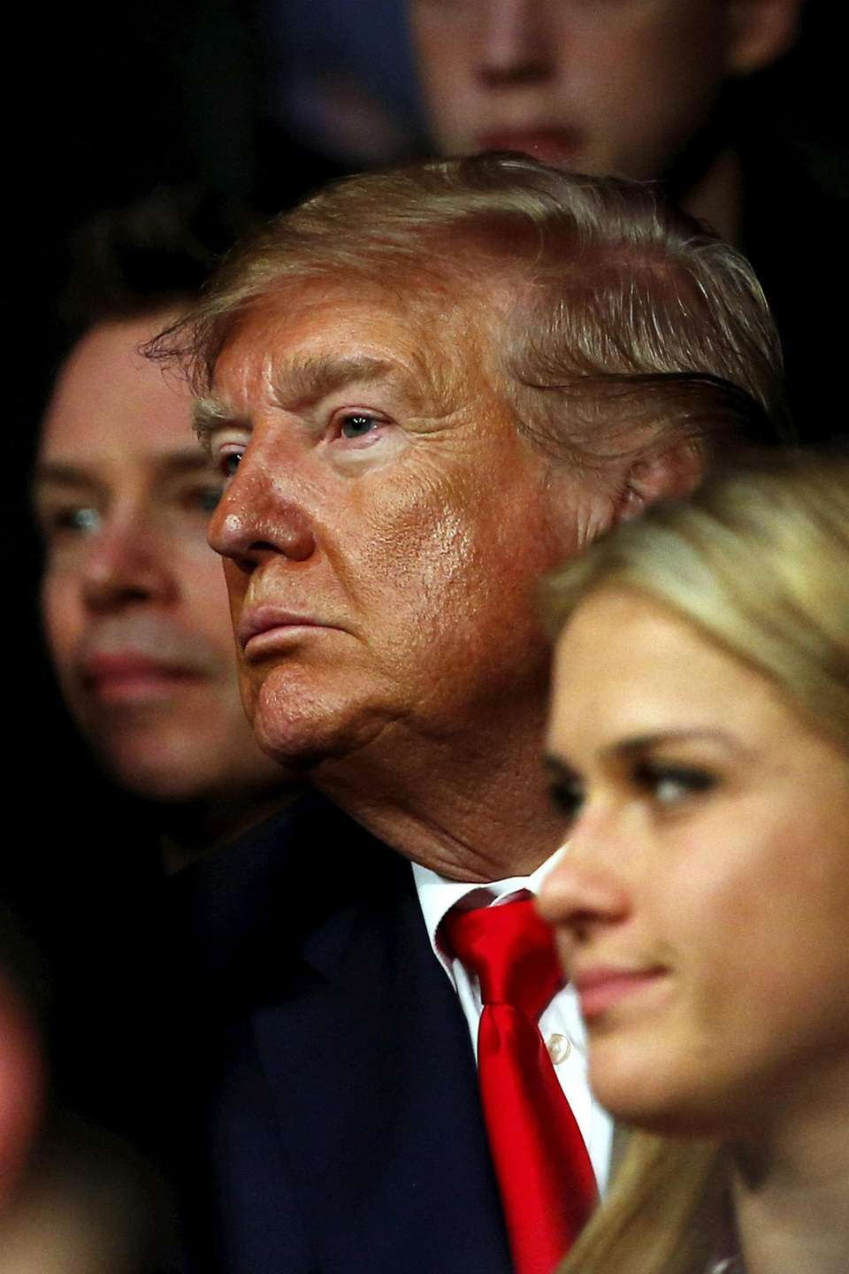 President Donald Trump watches the fights during the