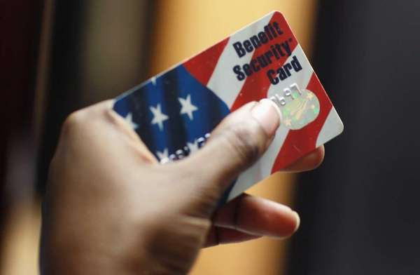 A social worker displays a Federal food stamps