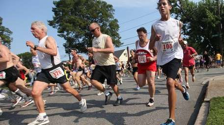 Runners break from the starting line during the
